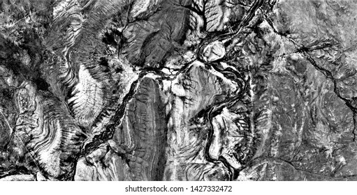 metastasis of the earth, black gold, polluted desert sand, black and white photo, abstract photography of the deserts of Africa from the air, aerial view, abstract naturalism, contemporary photo art,