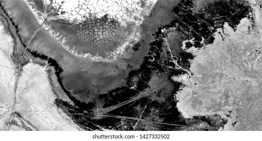 metastasis of the earth, black gold, polluted desert sand, black and white photo, abstract photography of the deserts of Africa from the air, aerial view, abstract naturalism, contemporary photo art