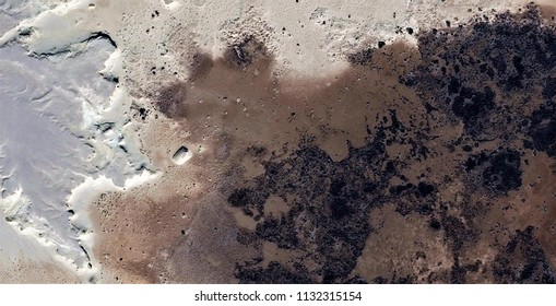 metastasis,black gold,polluted desert sand,tribute to Pollock, abstract photography of the deserts of Africa from the air, aerial view, abstract expressionism, contemporary photographic art