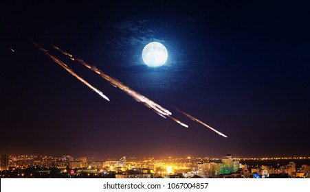 Meteor, asteroid, meteorite shower destroying city on earth. Elements of this image furnished by NASA.
