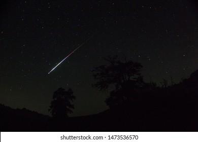 Meteor. Perseid meteor shower. Night sky stars and meteors