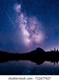 Meteor shower over a mountain lake.