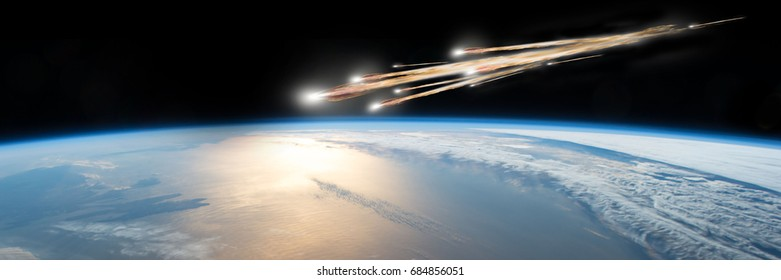 A meteor streaks towards a collision with Earth as it breaks up over the ocean.  Clouds cover an ocean area of the planet. Elements of this image furnished by NASA.