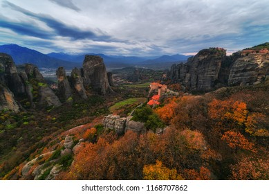 Meteora in Autumn with yellow and red trees. Monastery of Rousanou in the foreground!