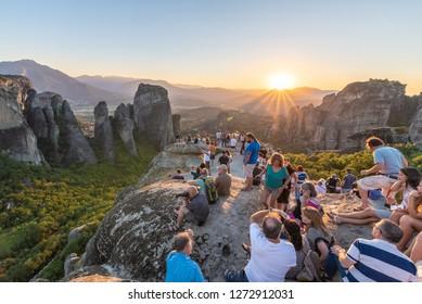 Meteora, Greece - 01 September, 2017: A group of people watching sunset on Meteora