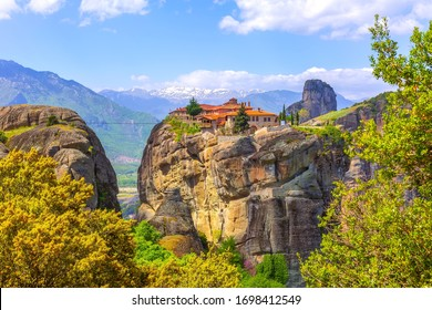 Meteora, Greece Agios Stefanos St Stefan Monastery on cliff mountain rock and snow peaks