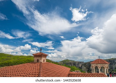 Meteora, Greece -  April 2019 : Red tiled rooftop of an ancient orthodox church in Varlaam Monastery