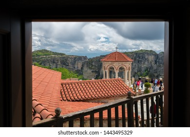 Meteora, Greece -  April 2019 : Tourists walking on the courtyard in the Varlaam Monastery
