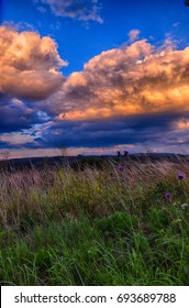 Meteorological photo - Bright clouds over the meadow in the summer.