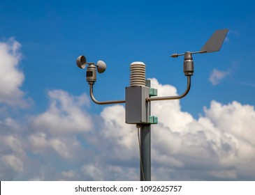 Meteorological system station with anemometer and wind vane. Automatic weather station for monitoring ambient air pressure, humidity, temperature, wind speed and direction.