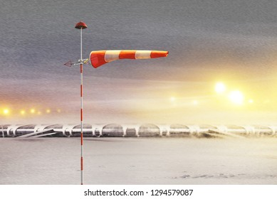 Meteorology windsock inflated by wind in airport at  not flying night