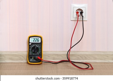 Metering socket voltage with digital multimeter.