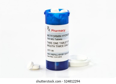 Metformin prescription bottle.  Metformin is a generic medication name and label was created by photographer.