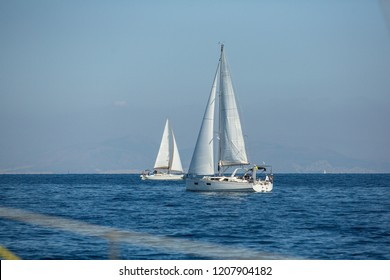 METHANA, GREECE - OCT 7, 2018: Sailors participate in sailing regatta 20th Ellada Autumn 2018 among Greek island group in the Aegean Sea, in Cyclades and Saronic Gulf.