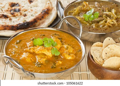 Methi Chicken, or Butter Chicken, with lamb dhansak, naan bread and poppadums.