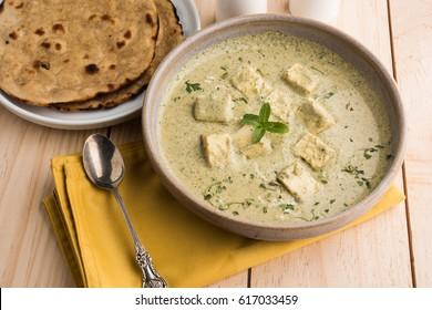 Methi Malai Paneer or Creamy Fenugreek & Cottage Cheese Curry,  Popular North Indian recipe, served in Ceramic Bowl with Roti/Paratha, selective focus