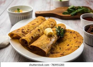 Methi Paratha (Thepla) / Indian flat bread using fenugreek leaves, selective focus