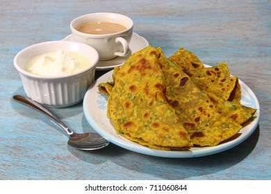 Methi Paratha,an Indian flatbread stuffed with fenugreek leaves and spices served in breakfast or brunch .