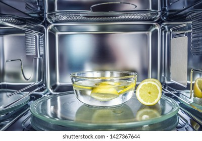 A method of cleaning in a microwave oven with water and lemon.