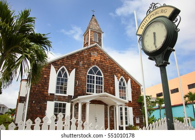 The Methodist Church with a traditional street clock outside, Philipsburg, St Maarten, Caribbean.