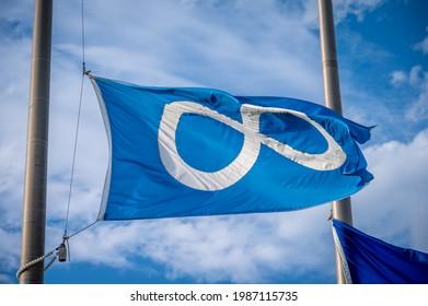 Metis flag in Calgary flying at half mast.