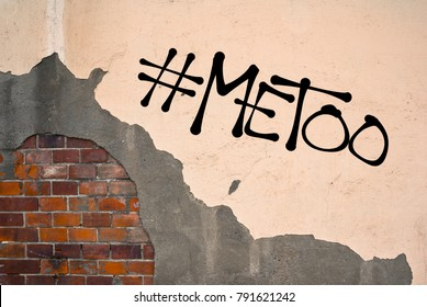 MeToo - handwritten graffiti sprayed on the wall - allegation on sexual abuse, harassment, assault, incident, unwanted and nonconsensual rape and sex, physical violence.