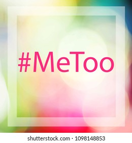 MeToo hashtag on abstract blur of light colorful bokeh background. #metoo as a new movement. As part of anti sexual harassment.