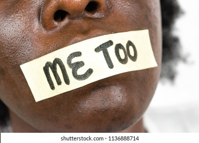 #metoo as a new movement. Black African American woman showing with text me too tape across her mouth for sexual misconduct and censorship concept