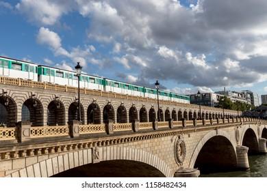 Metro crossing Bercy bridge - Paris, France