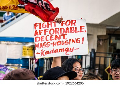 Metro Manila, Philippines. 25th February 2020. A protester holding a protest sign that promotes affordable housing for the urban poor during the protest on the 34th anniversary of the EDSA Revolution.