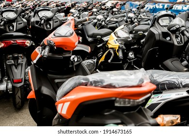 Metro Manila, Philippines - Feb 2021: A batch of new Motorcycles parked at a dealership lot. A fresh inventory that was recently delivered.