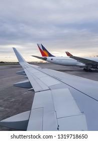 Parañaque, Metro Manila / Philippines - January 15 2019: Philippine Airline Airbus 321 arriving at at NAIA Ninoy Aquino International Airport Terminal 2