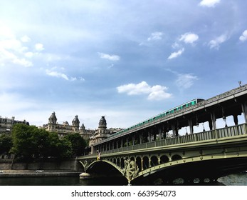 Metro in Paris at Bir-Hakeim bridge over the seine river with sky on background -Photo from mobile
