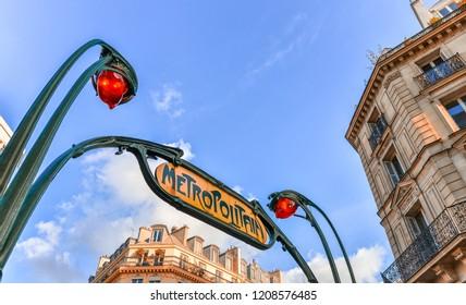 Metro sign in Paris street.