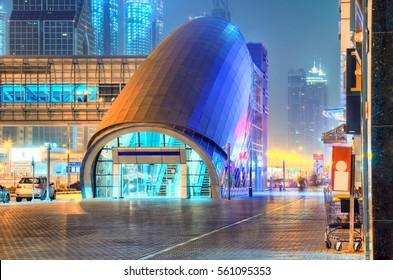 Metro station ad skyscraper of Dubai by night.
