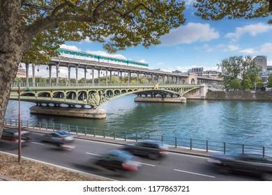A metro train crossing the Pont de Bir-hakeim in Paris