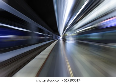 metro train passing by in station, speed background