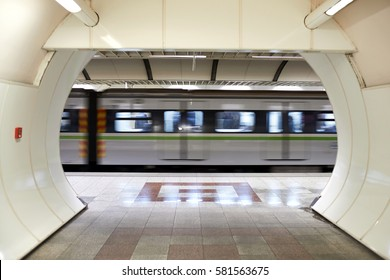 Metro train speeding up in the subway