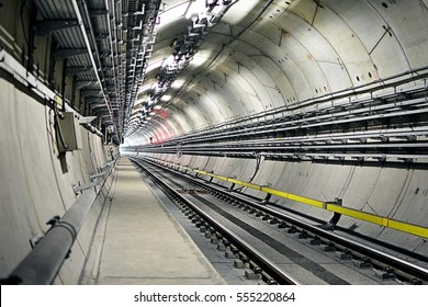 Metro tunnel (subway or underground) with precast concrete linings (segments or rings) with lights of an approaching train