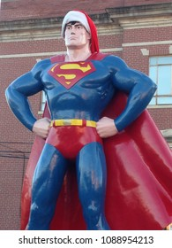 Metropolis, IL / USA - December 15, 2015: A 15-foot-tell bronze statue of Superman is decked out and ready for Christmas in Metropolis, IL, official hometown of the Man of Steel.