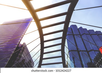 The metropolis and sky walk with city background at Chong Nonsi in Bangkok Thailand. It is very famous landmark of Thailand with beautiful sunlight in the morning and beautiful building background