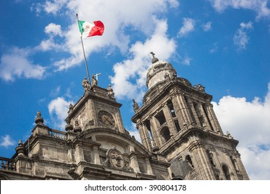 Metropolitan cathedral of Mexico city in Zocalo square and mexican flag.