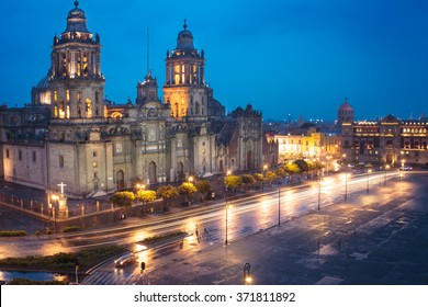 Metropolitan Cathedral and President's Palace in Zocalo, Center of Mexico City Mexico Sunrise night.