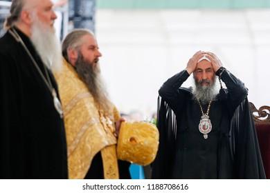 Metropolitan Onufriy (head of the Ukrainian Orthodox Church (Moscow Patriarchate)) (R) during the liturgy in Kyiv, Ukraine.  27-07-2016