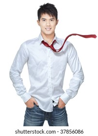 Metrosexual, handsome chinese hunk in white shirt,  blue jeans.  Superman lookalike, with red, windswept, flying tie.