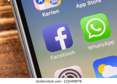 METTINGEN, GERMANY - NOVEMBER 9, 2018: Close up to facebook app on the screen of an iPhone X with personalized background