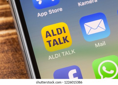 METTINGEN, GERMANY - NOVEMBER 9, 2018: Close up to ALDI TALK app on the screen of an iPhone X with personalized background