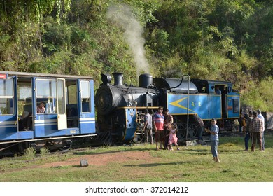 Mettupalayam, India - October 29, 2015 - Tourists in front of famous toy train in Unesco World heritage