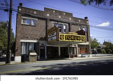 METUCHEN, NJ - SEPTEMBER 23: A view of the historic Forum Theater. The marquee shows that Woody Allen's film, Blue Jasmine, will be playing there. Photo taken September 23, 2013.
