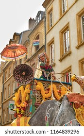METZ, FRANCE - AUG 26, 2018: people enjoy the performance at the The Mirabelle Plum Festival in Metz, France. people in fifferent costumes perform a parade watched by thousands of locals and tourists.